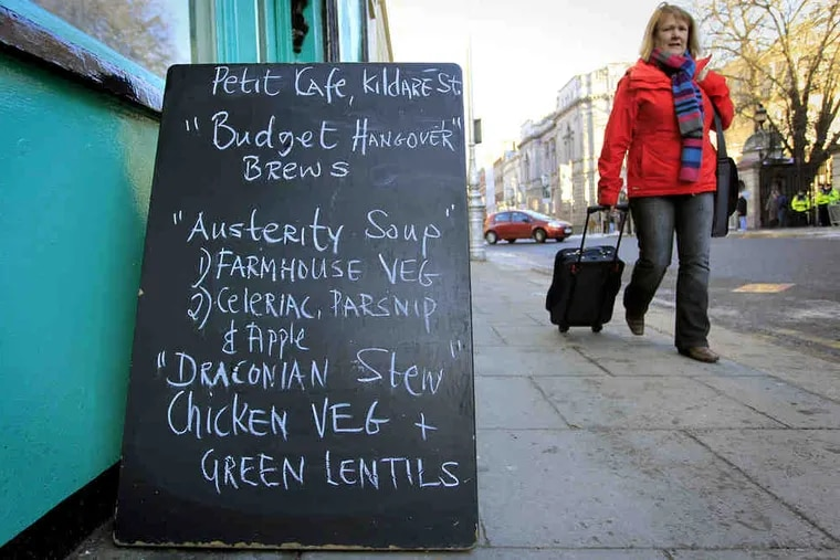 A Dublin cafe takes note of the economic crisis. On Tuesday, legislators narrowly backed a budget with $8 billion in cuts and tax increases costing a typical household $4,000 a year - key conditions for an EU/IMF bailout.