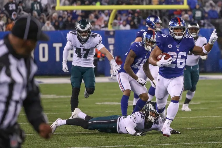Giants running back Saquon Barkley breaks a tackle from Eagles cornerback Sidney Jones and runs for a 68 yard touchdown in the third quarter.