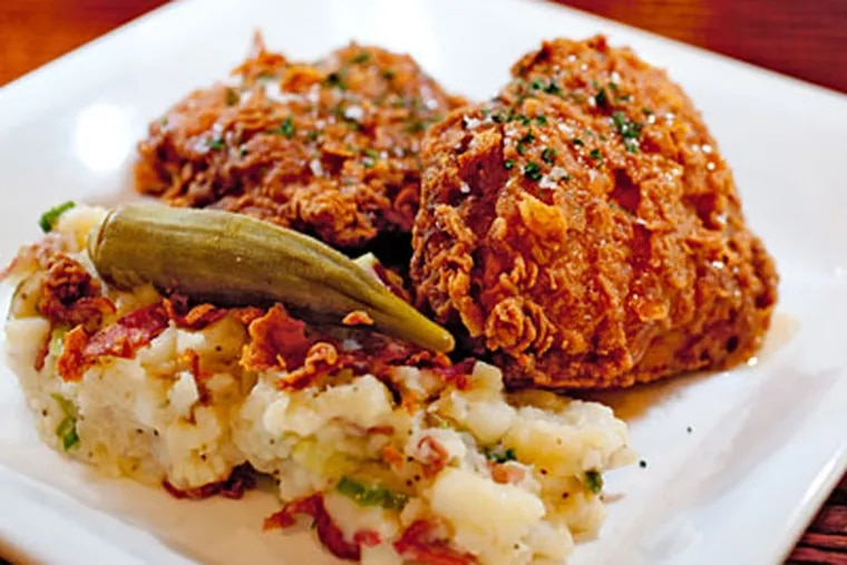 Resurrection's twice-fried chicken with spiced honey graces Bon Appétit this month. And that potato salad's just the kind of super serendipitous side that pops up on the fried-chicken trail. (DAVID M WARREN / Staff Photographer)