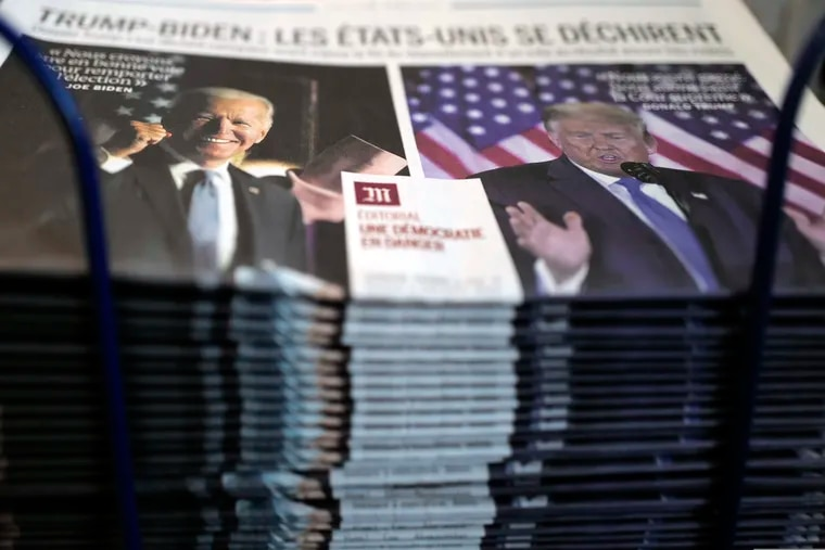 """A pile of French newspaper Le Monde headlines """"Trump-Biden : the United States is tearing itself apart, Editorial : a democracy in danger"""" about the U.S. presidential elections, at a newspapers stand in Paris, Wednesday, Nov. 4, 2020. The world is watching as millions of Americans cast their ballots for the next president on Tuesday. (AP Photo/Francois Mori)"""