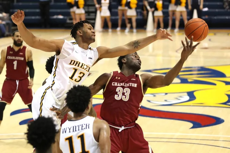 Tim Perry, top left, of Drexel and Osinachi Smart, right, of Charleston go after a rebound during the 2nd half on Dec. 28, 2019.