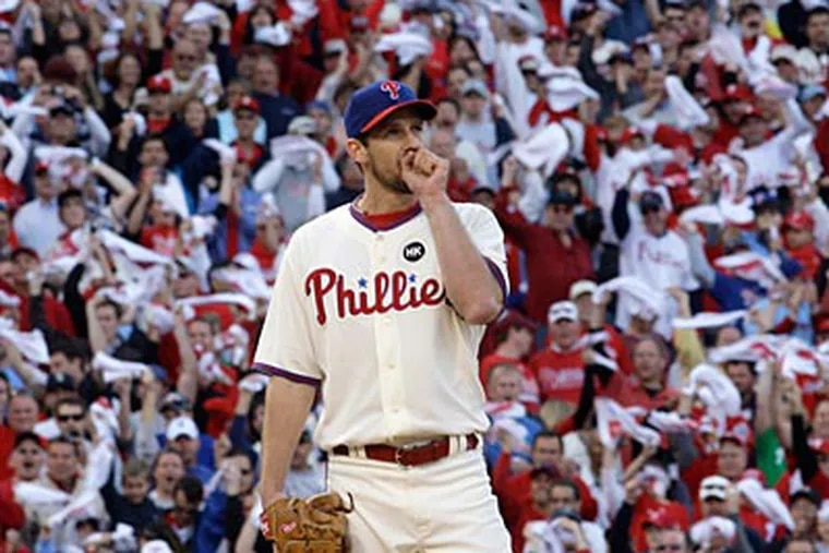 """""""I guess [Cliff Lee] will be the savior of Philly - if we win it next year,"""" said Eteecio Bussie Sr., 41, of Levittown. (AP file photo/Mel Evans)"""