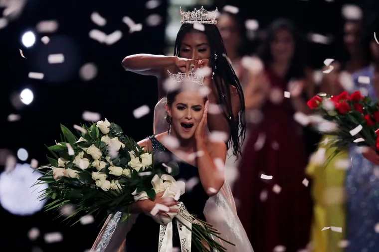 Camille Schrier, of Virginia, reacts as she is crowned after winning the Miss America competition at the Mohegan Sun casino in Uncasville, Conn., Thursday, Dec. 19, 2019. At rear is 2019 Miss America Nia Franklin.