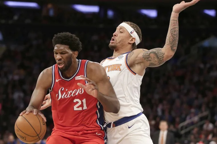 Philadelphia 76ers' Joel Embiid, left, and New York Knicks' Michael Beasley battle for position during the second half of an NBA basketball game, Monday, Dec. 25, 2017, in New York. The 76ers defeated the Knicks 105-98.