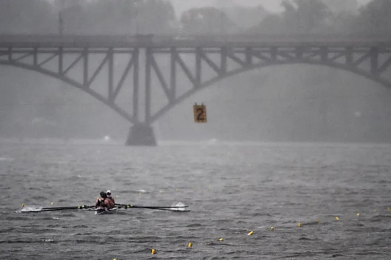 Rowers compete in a race during a downpour at the 76th Aberdeen Dad Vail Regatta on the Schuylkill River in Philadelphia, Saturday May 10, 2014. (Joseph Kaczmarek/AP)