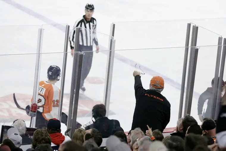 A Flyers fan offers his glasses to an official after a penalty was called in the third period of a 2019 game against the Washington Capitals.