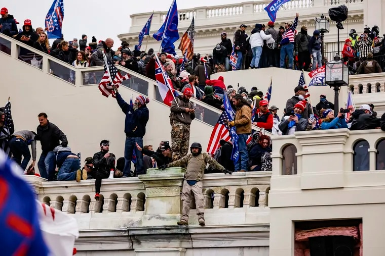 Pro-Trump supporters storm the U.S. Capitol following a rally with President Donald Trump on Wednesday, Jan. 6, 2021 in Washington, D.C. Congress held a joint session today to ratify President-elect Joe Biden's 306-232 Electoral College win over President Donald Trump. A group of Republican senators said they would reject the Electoral College votes of several states unless Congress appointed a commission to audit the election results.