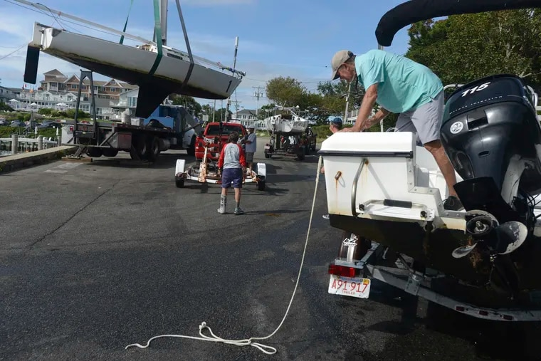 Baxter Crane Company hauls a yacht onto a trailer in Hyannis. Mass., in preparation for a visit from Henri.