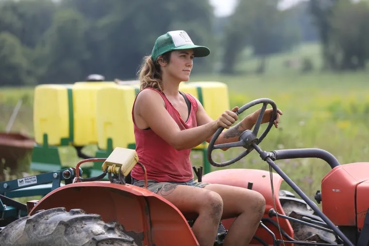 Emma Cunniff on a tractor at her farm, Kneehigh Farm on Coventryville Road in Pottstown, Chester County, Pa., in Aug. 16, 2018.