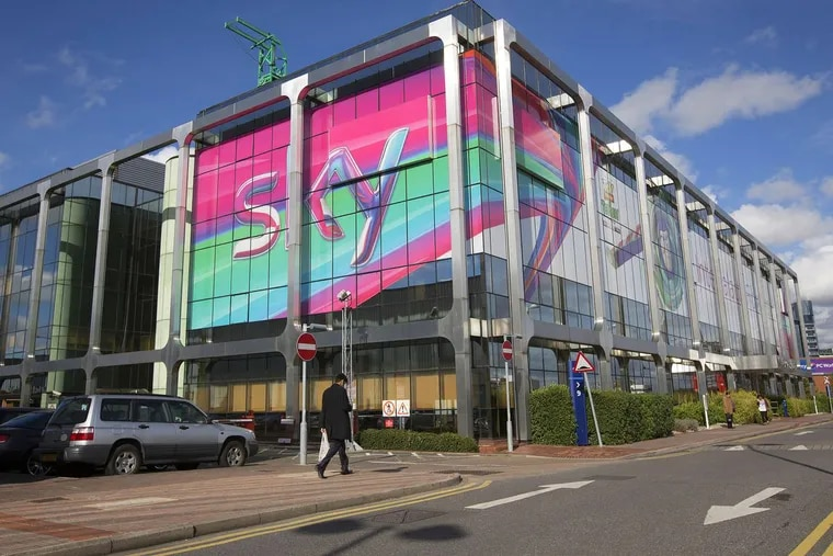 A giant Sky logo sits in the windows of a building at British Sky Broadcasting Group Plc's (BSkyB) headquarters in London.