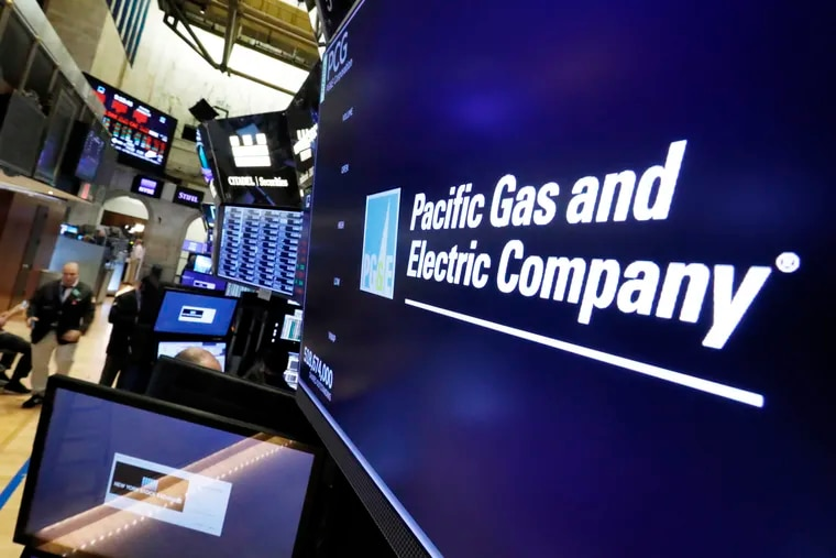 This Jan. 14, 2019 photo shows the logo for Pacific Gas & Electric Co. above a trading post on the floor of the New York Stock Exchange. The utility's wildfire liabilities forced it to enter bankruptcy. Now smaller businesses that need to file for bankruptcy will have an easier time, thanks to a new law.  (AP Photo/Richard Drew, File)
