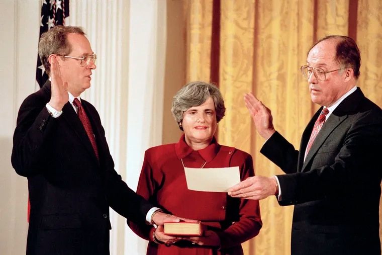 In this Feb. 18, 1988, file photo Anthony Kennedy, left, takes the constitutional oath as a Supreme Court Associate Justice from Chief Justice William Rehnquist at a White House ceremony in Washington. Holding the Bible is Kennedy's wife, Mary Kennedy. The 81-year-old Kennedy said Tuesday, June 27, 2018, that he is retiring after more than 30 years on the court.