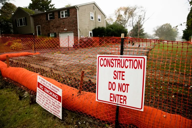 A sign is posted at a construction site on the Mariner East pipeline in a residential neighborhood in Exton.