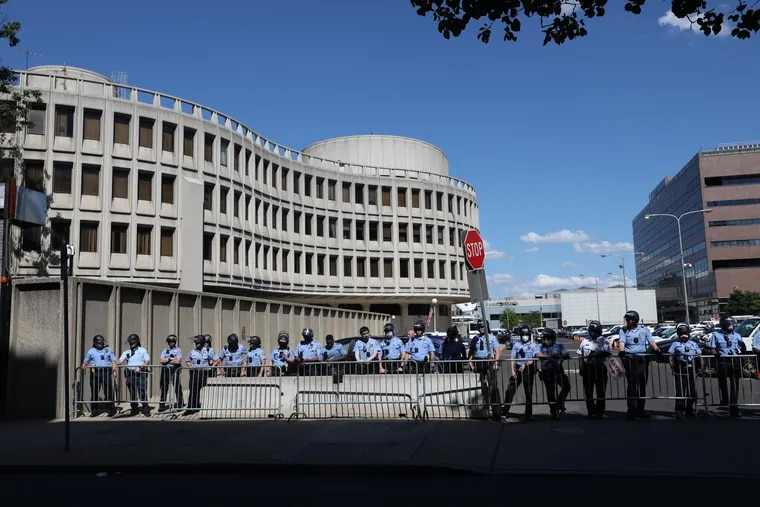 Police guard the Roundhouse amid protests against the death of George Floyd in May. The 911 dispatchers who work on the second floor told City Council on Thursday that their jobs are becoming increasingly difficult.