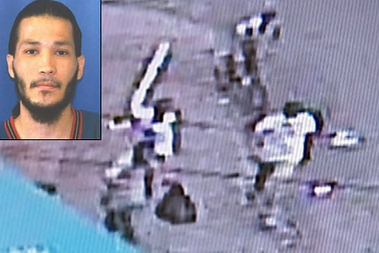 """This corner-store camera video shows Jose Carrasquillo (inset) carrying a black bag Tuesday just before he was chased on Clearfield Street, caught and beaten. The attack left him in critical condition at Temple University Hospital. Police were thanking the locals for helping them catch """"a person of interest."""" (Courtesy Fox 29)"""