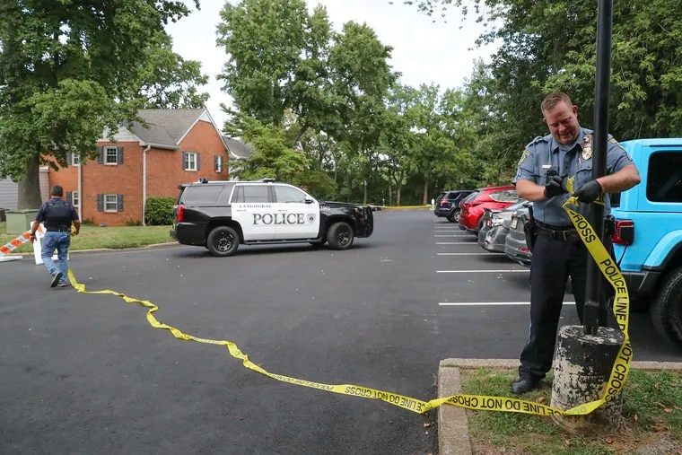 Police secure the scene of the Yardley Commons Condominium Complex where a standoff with an armed man took place on Wednesday. Yardley Police Chief Joseph Kelly was shot in the confrontation.