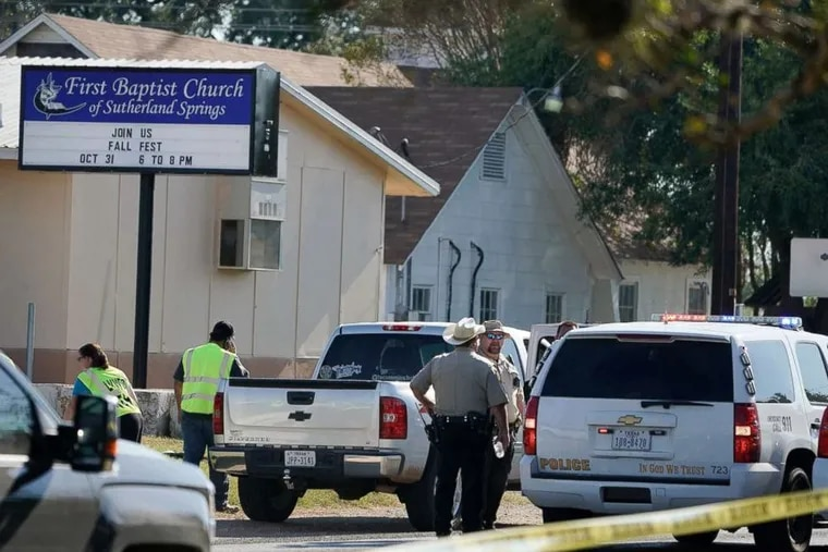 Law enforcement officers gather in front of the First Baptist Church of Sutherland Springs