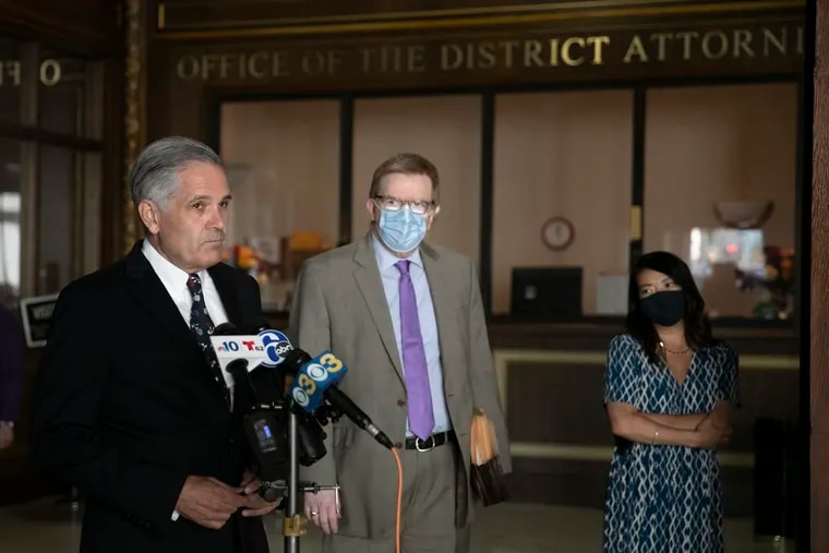 Philadelphia District Attorney Larry Krasner (left) speaks during a media availability regarding filing charges against police officer Richard Nicoletti at his Center City office on Wednesday, July 22, 2020. Nicoletti, a Philly SWAT officer, turned himself in after pepper spraying kneeling protesters on I-676 in June.