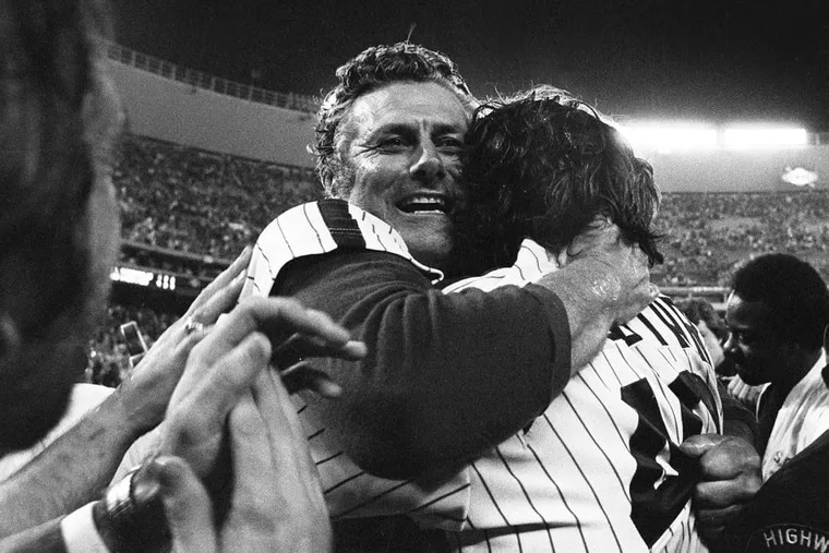 Manager Dallas Green hugs one of his players after the 1980 Phillies won the World Series championship at Veterans Stadium.