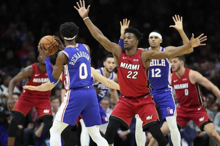 Jimmy Butler (22) of the Heat in a zone defense against the Sixers last week.