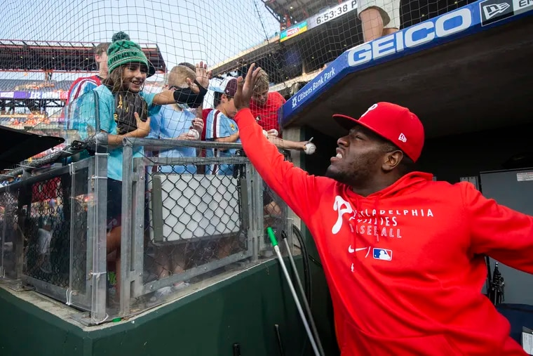 Hector Neris of the Phillies high-fives fans before the game against the Rays on Aug. 24.