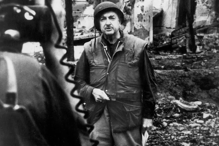 CBS News anchor Walter Cronkite reports from a bombed out building after the Tet offensive during the Vietnam War in 1968.