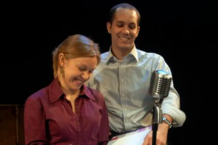 """Erin Reilly, who acts in """"Holiday Show at the Swing Club,"""" and Matthew Decker, who directs the production, review the script on stage at the Norristown Cultural Center. The show will begin Tuesday."""
