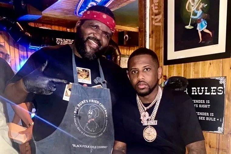 "Reuben ""Big Rube"" Harley (left) with rapper Fabolous at Pitchers Pub."