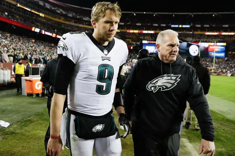 Eagles quarterback Nick Foles leaves the game with a team official during the fourth-quarter against Washington on Sunday, December 30, 2018 in Landover, MD.