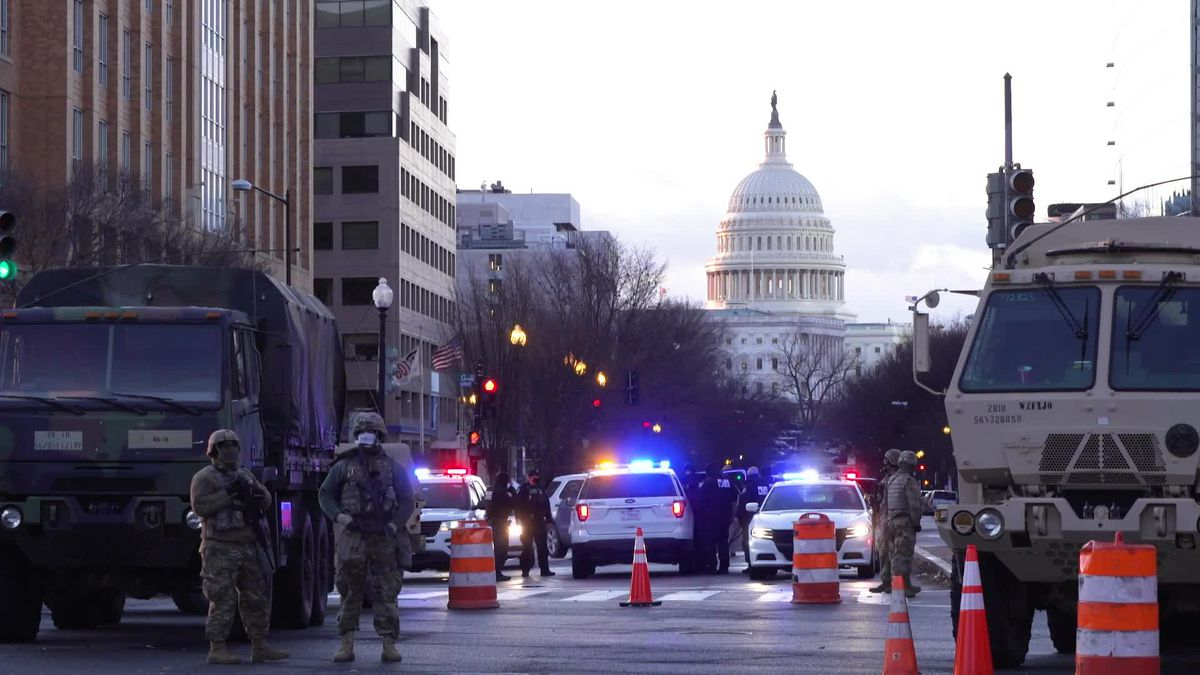 As National Guard secures Washington, Biden supporters celebrate Inauguration Day behind barricades