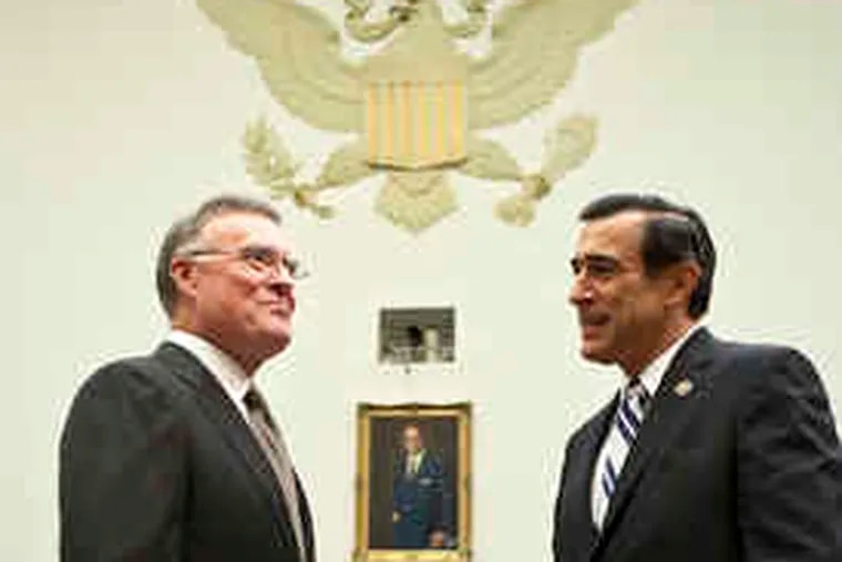 Kenneth D. Lewis (left), CEO of Bank of America, speaks with Rep. Darrell Issa (R., Calif.), before testifying to the House Committee on Oversight and Government Reform. Lewis said yesterday that he proceeded with the Merrill deal because of pressure from regulators.