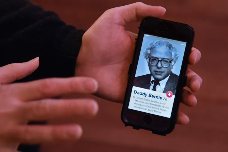 Alex Scheinberg swipes on his profile on Philly Tinder in his bedroom in his parents' Collingswood home, with his photo showing Bernie Sanders in 1991.