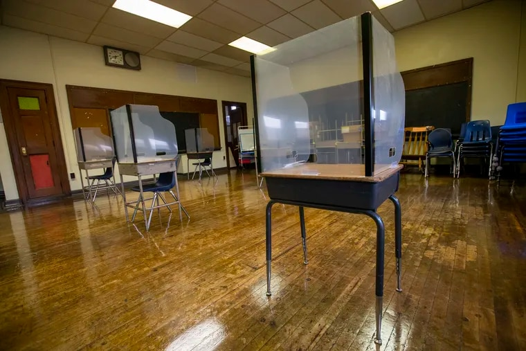 Classroom with protective shields at desks