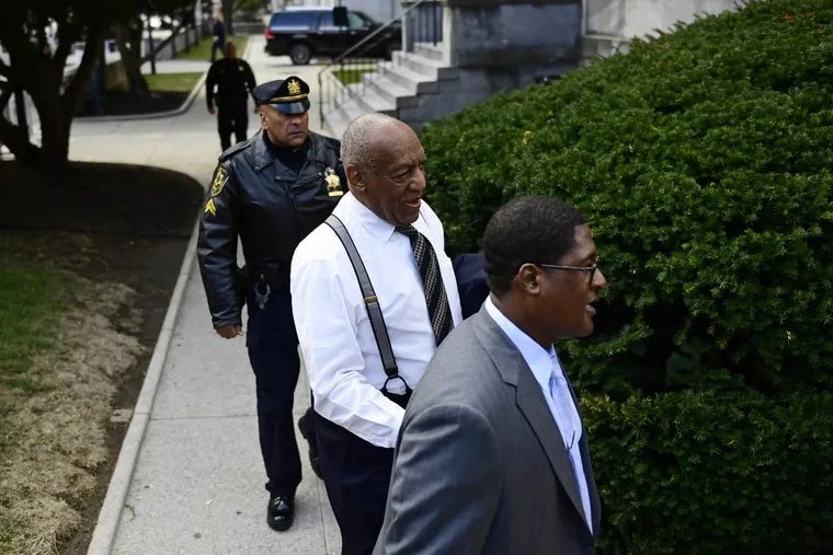 Bill Cosby, center, arrives with spokesperson Andrew Wyatt, right, for his sexual assault trial at the Montgomery County Courthouse on Thursday, April 5, 2018, in Norristown, Pa.