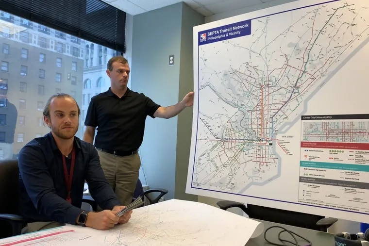 SEPTA's Lex Powers (right) and Andrew Busch show off the new transit system map, which will soon show up across the city.
