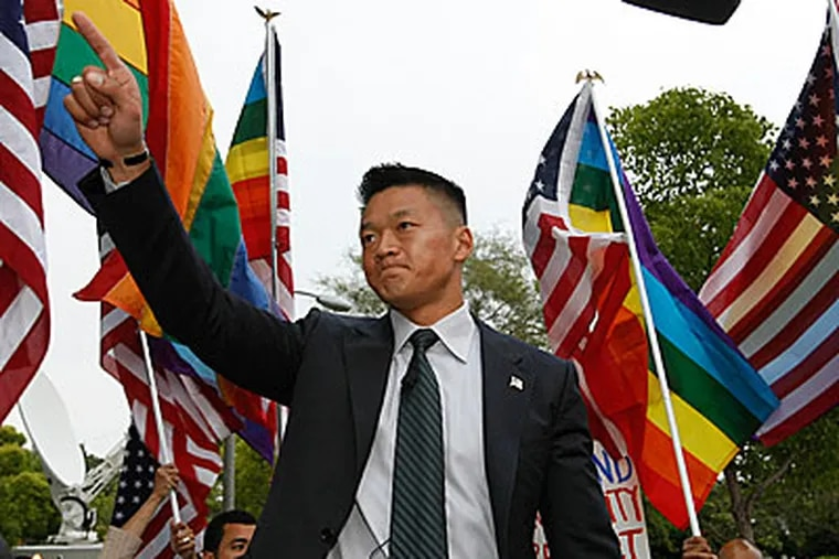 Former Army National Guard Lt. Dan Choi, an Arabic-speaking specialist dismissed through the 'Don't Ask, Don't Tell' policy, comments on Proposition 8, outside the Beverly Hills hotel, where U.S. President Barack Obama attended a benefit dinner in Beverly Hills, Calif. on Wednesday, May 27, 2009. (AP Photo/Damian Dovarganes)