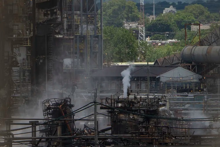 A view of the damaged refinery at the Philadelphia Energy Solutions (PES) as seen from the George C. Platt Memorial Bridge.
