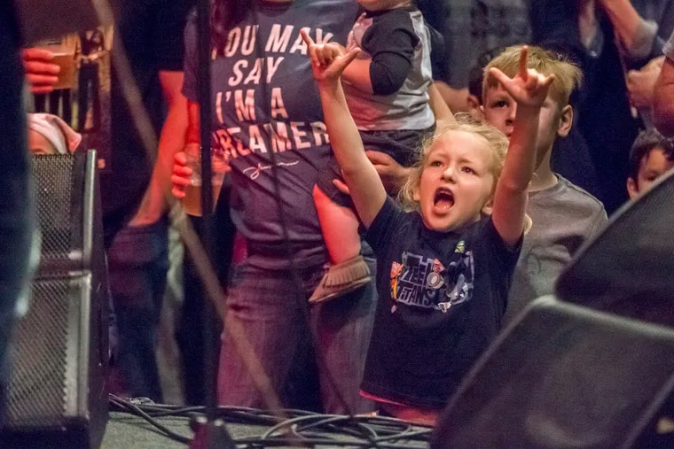 Charlotte Klinghoffer, 6 1/2, voices her approval as the Rock and Roll Playhouse band takes the stage to play Beatles music during their concert at the Ardmore Music Hall on May 13, 2018. The Rock and Roll Playhouse does kid-friendly cover songs of classic rock bands