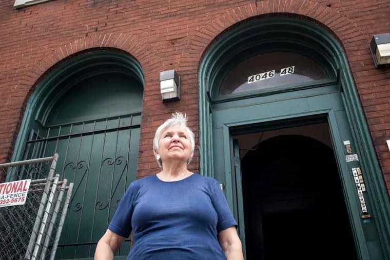 University City Historical Society President Elizabeth Stegner on the steps of a Chester Street rowhouse.