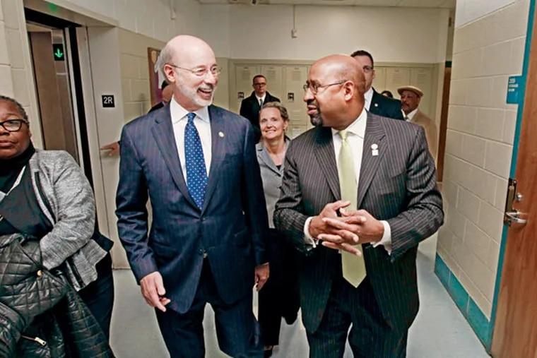 Gov. Wolf (left) and Mayor Nutter walk the halls of Kensington Health Sciences Academy. (MICHAEL BRYANT / Staff Photographer)
