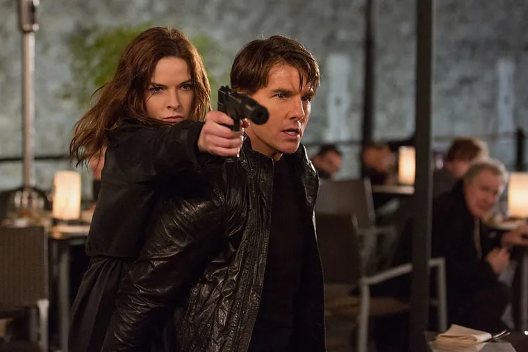 """In this image released by Paramount Pictures, Rebecca Ferguson, left, and Tom Cruise appear in a scene from """"Mission: Impossible - Rogue Nation."""""""