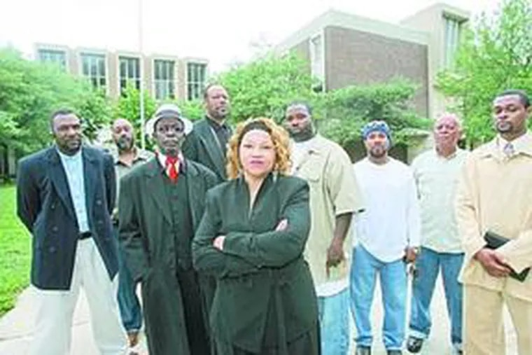 Parent Arenda Bethel (center) at Ada H. Lewis Middle School with other concerned residents, contractors and engineers.