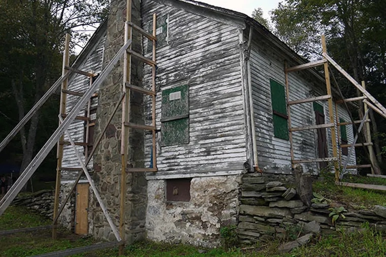 The Dennis Farm homestead, built in the 1800s, is propped up by supports. Architects say they are working to stabilize the structure to prevent further deterioration – they're going to build a pole-barn roof canopy over the whole structure while restoration work starts. ( Andrew Maykuth / Staff )