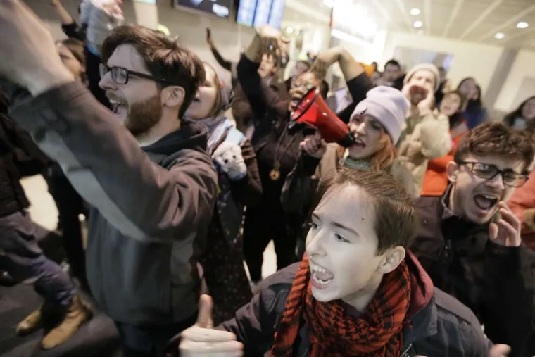 Demonstrators at Philadelphia International Airport in January 2017 protest President Trump's ban of refugees and immigrants from several Muslim-majority countries. Penn State's Shoba Sivaprasad Wadhia writes that the ban reflects a long line of harsh immigration policies stemming from the 9/11 attacks.