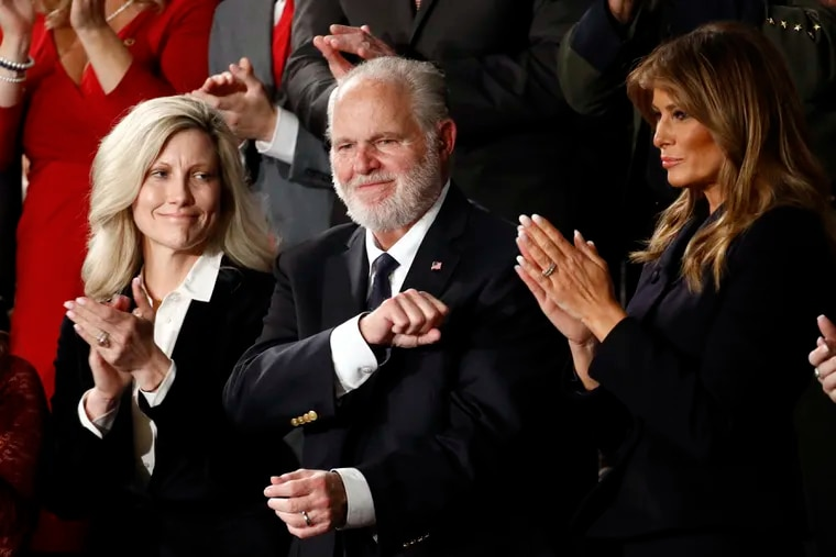 Rush Limbaugh reacts as first Lady Melania Trump, and his wife Kathryn, applaud, as President Donald Trump delivers his 2020 State of the Union address.