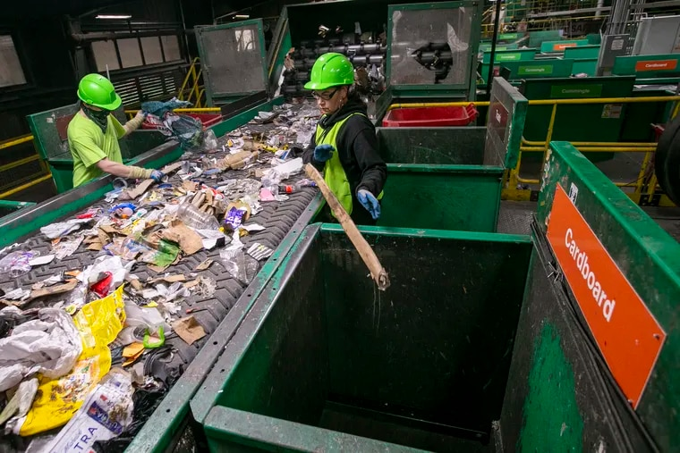 Isaiah Mayne and Rose Valentine (right) sort materials at the TotalRecycle plant in Birdsboro, Berks County.