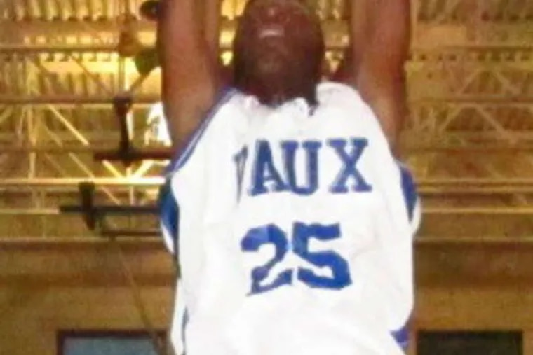 TED SILARY / DAILY NEWS STAFF Keith Fletcher throws down a dunk during Vaux victory.