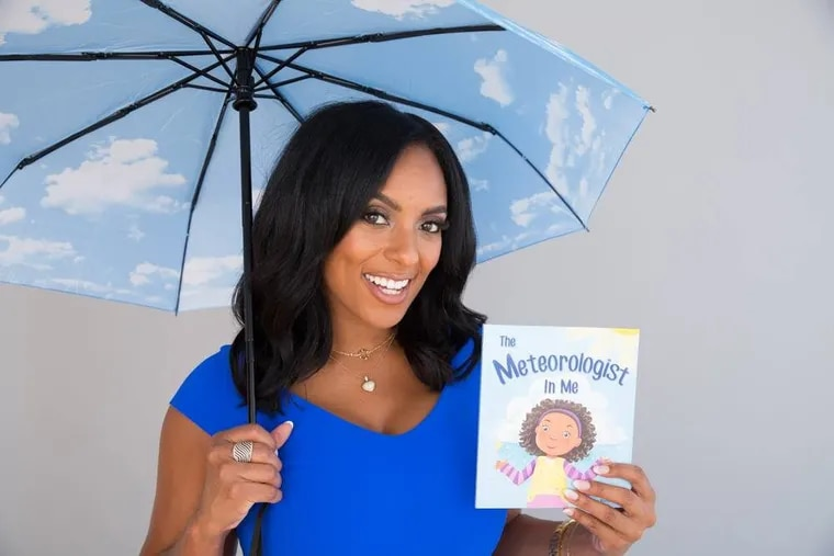 Brittney Shipp returns to NBC10. Here, she holds her children's book, The Meteorologist in Me.
