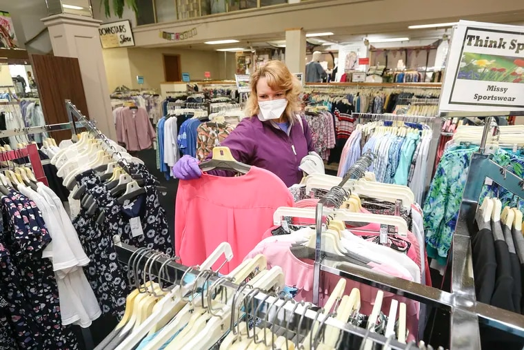 Beth Scheiderman from Mansfield shopping at Dunham's Department Store in Wellsboro, Tioga County, on its first day back open on May 8.