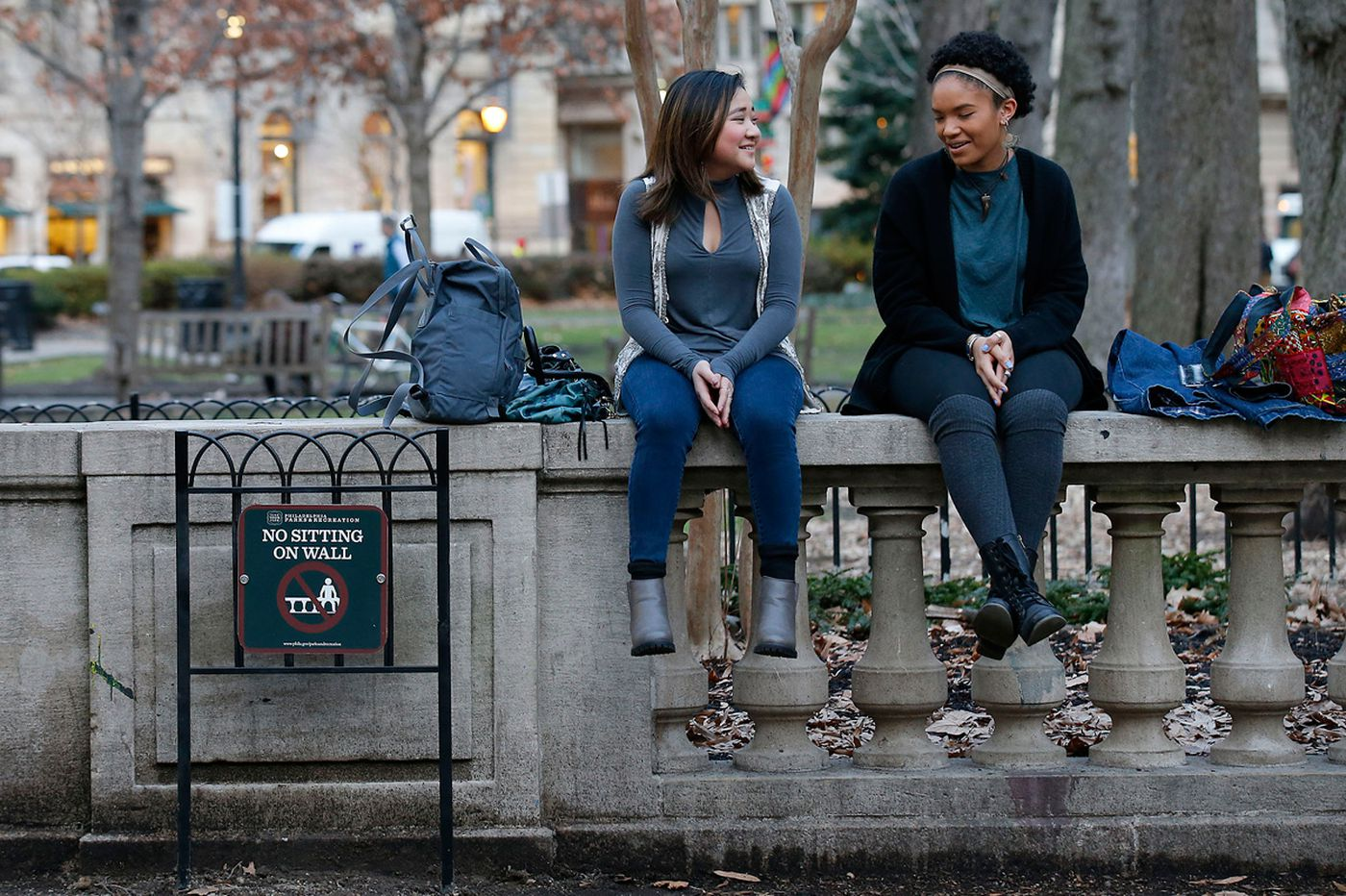 After loitering complaints, city bans wall sitting in Rittenhouse Square
